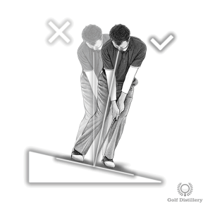 Tilt your spine forward when chipping from a downslope