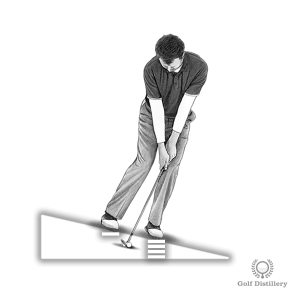 Position your weight on your front foot when hitting a downslope chip shot