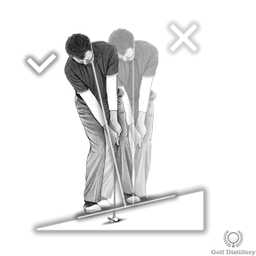 Tilt your spine back while setting up for an upslope chip shot