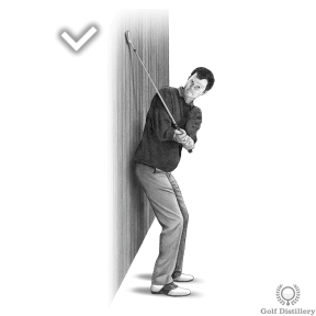 Backswing Drill - Step 3: Your clubhead should strike the wall at around head height